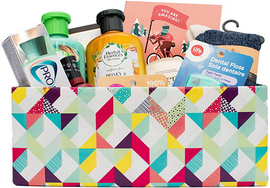 A decorative wrapped box filled with personal hygiene essential items.