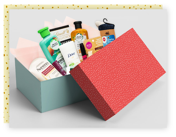 An open gift box with personal hygiene items, makeup, and chocolates.