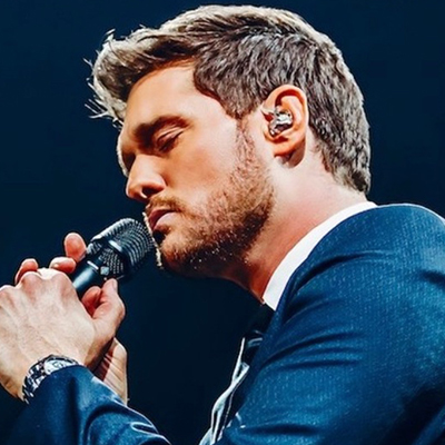 Michael Bublé holding a microphone close to his mouth