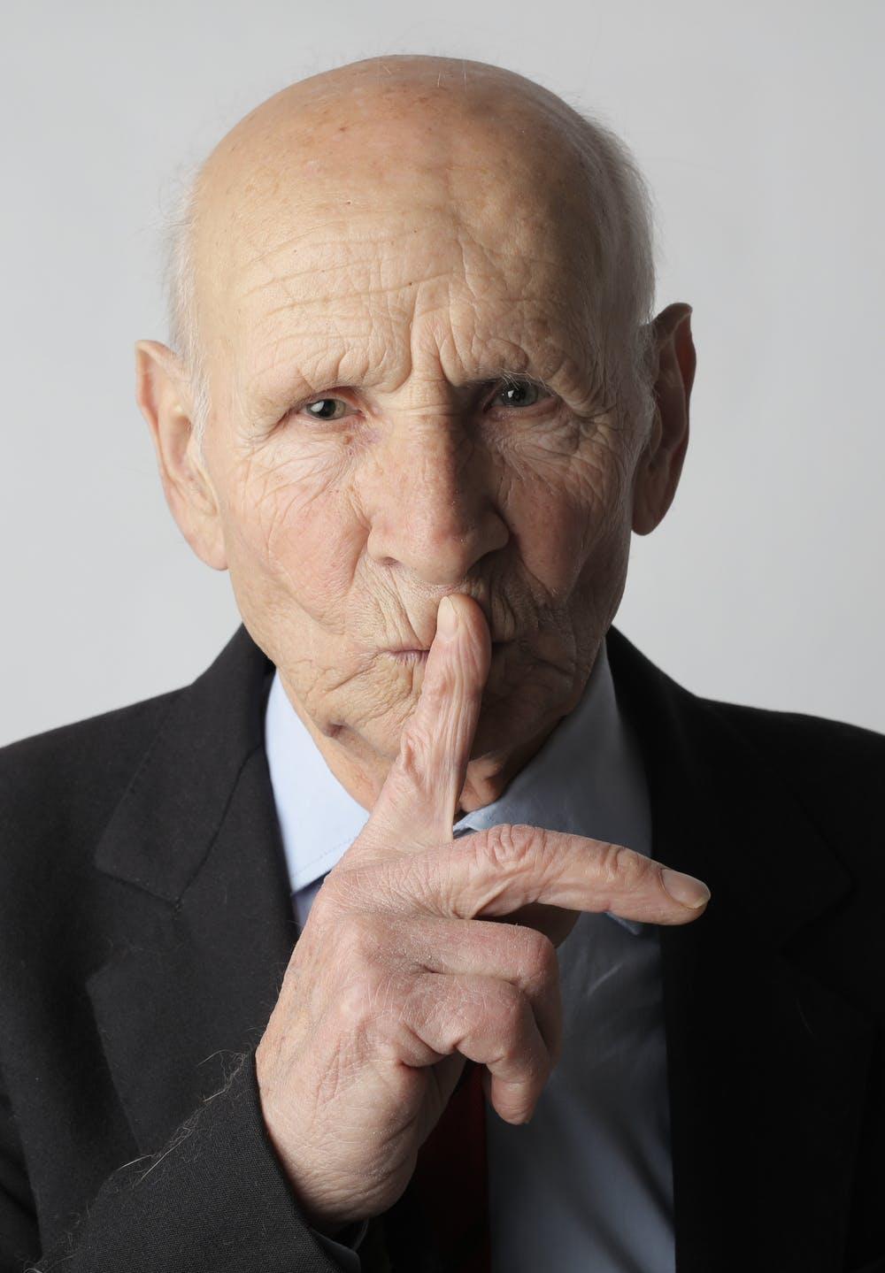 Old Man Gesturing Shh