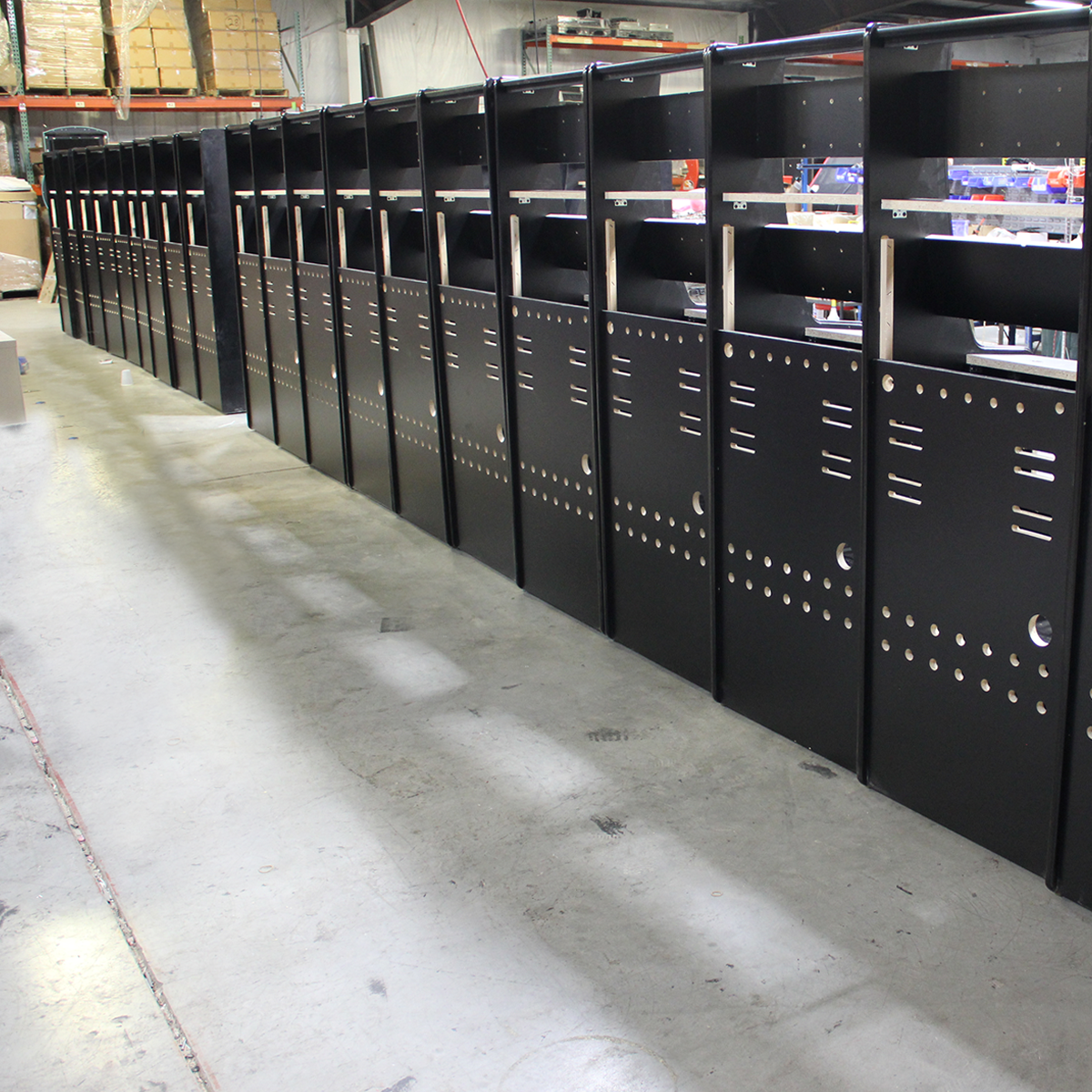Line of cabinets, ready for wiring.