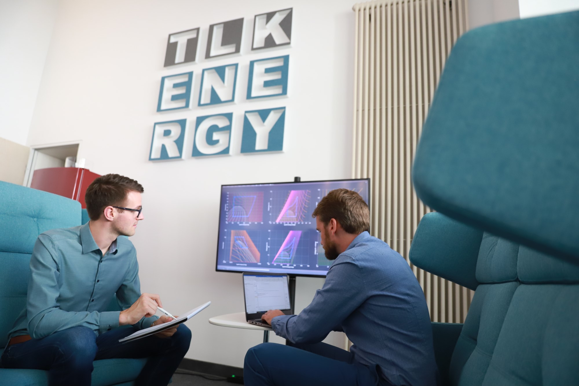 Two engineers working together on simulations