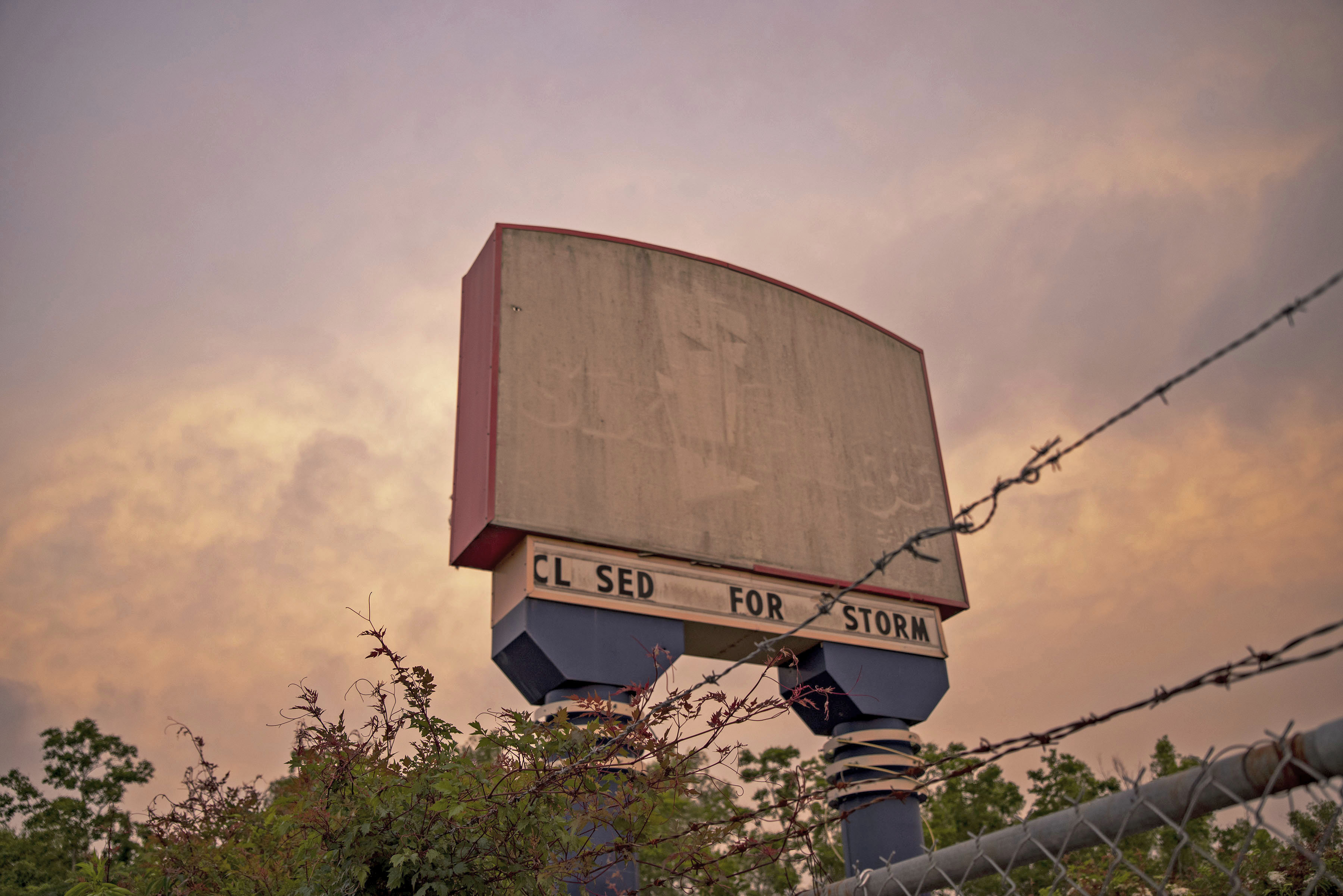 A derelict billboard from a foreclosed amusement park.