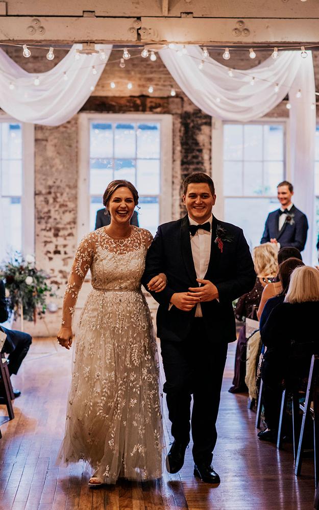 couple walks down aisle