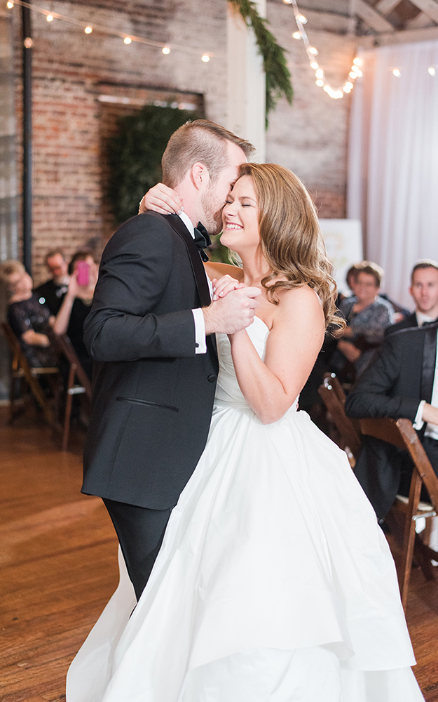 couple first dance smiling