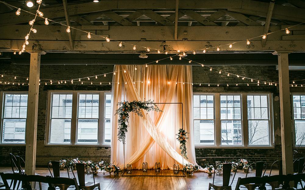 wedding setup with drape and flowers