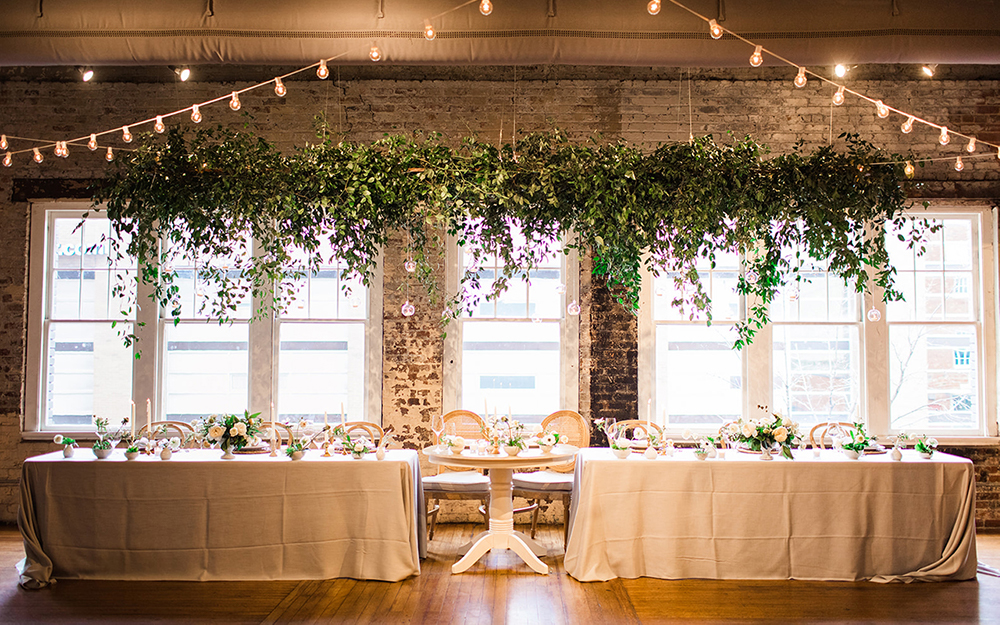reception head table under grennery