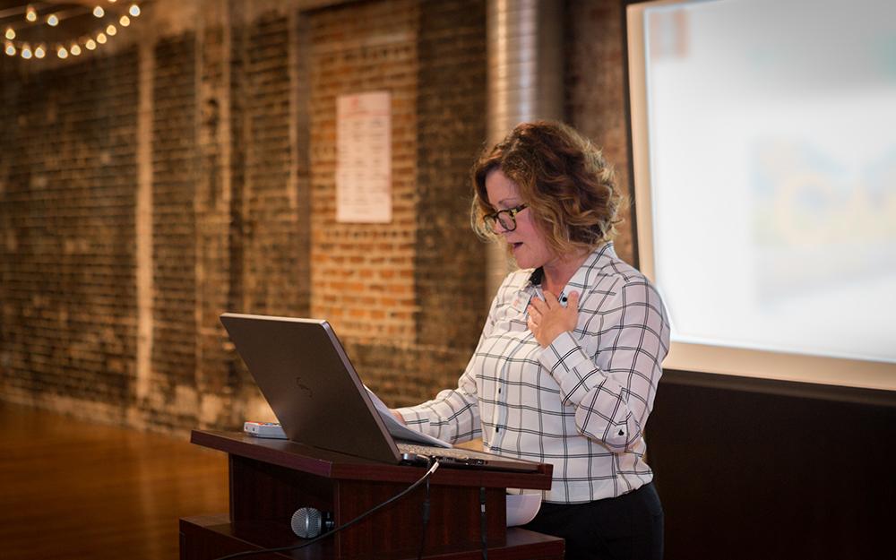 stockroom-event-woman-at-podium