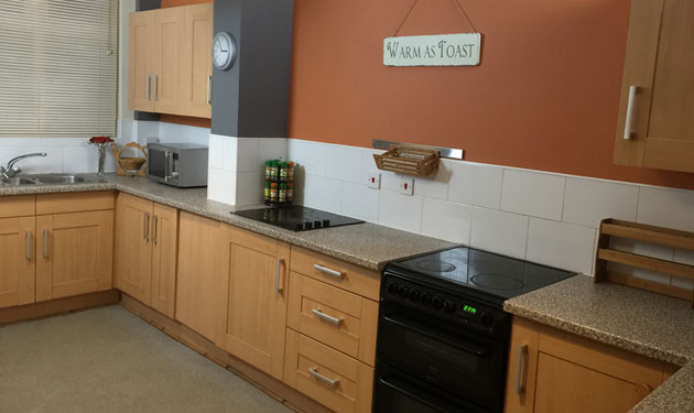 The bright and homely kitchen in contemporary terracotta and grey