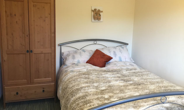 One of the cosy, comfortable bedrooms at Oatland Gardens