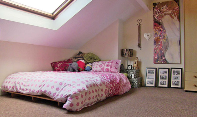 The big, sunny back attic bedroom in our 6-bed Ash Grove house with its big Velux window