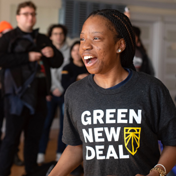A woman with a Green New Deal shirt