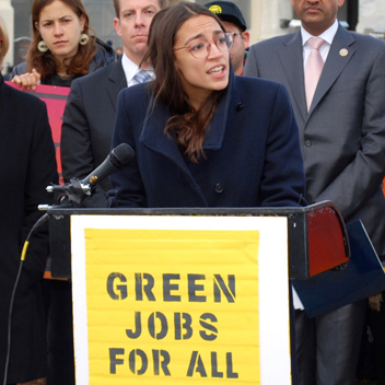 AOC speaking to a crowd about a Green New Deal