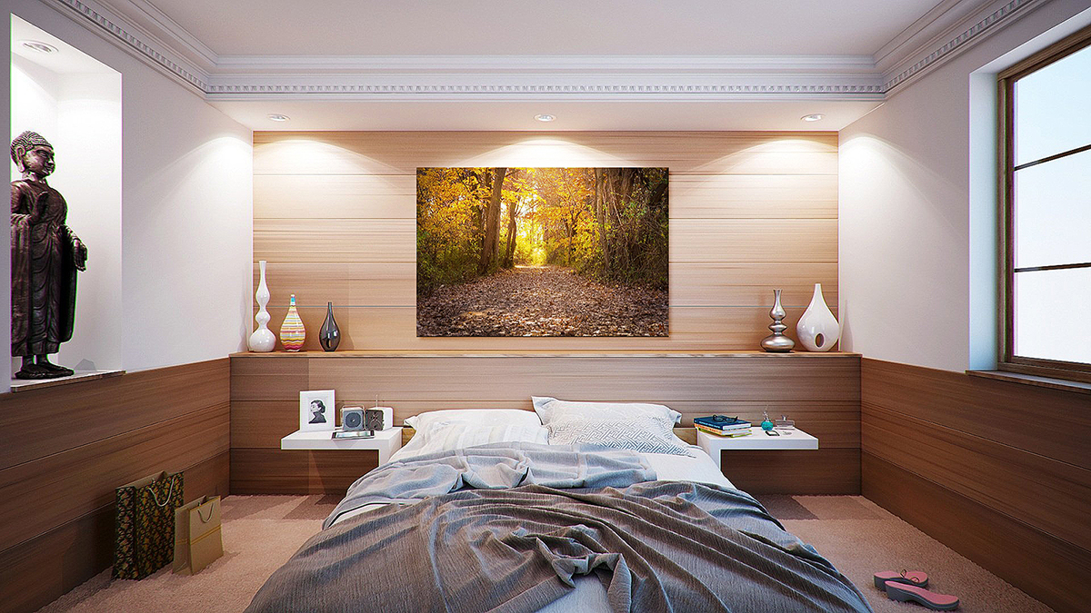 Picture of a bedroom with a large photography on the wall.