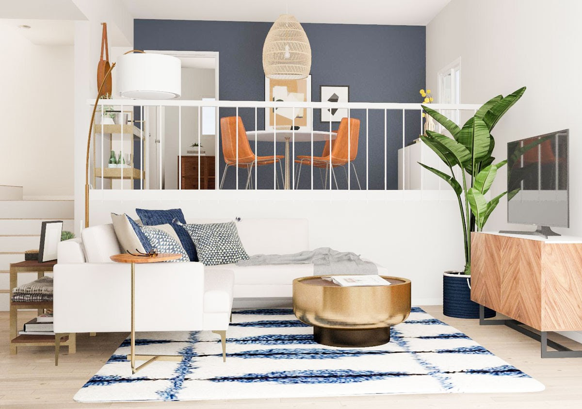 A split level living room with a good aesthetic using blue and white, and an orangey accent color