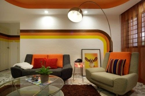 A split-level, 70's style remodel with bright orange paint and throwpillows