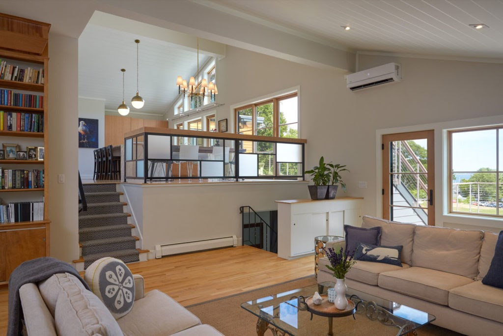 A split level home with a conversation pit below the dining room, in which people can be cozy and relax