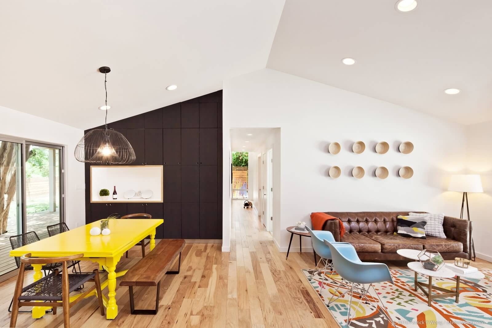 A ranch house living room with contemporary design elements, including bright colors and fun patterns