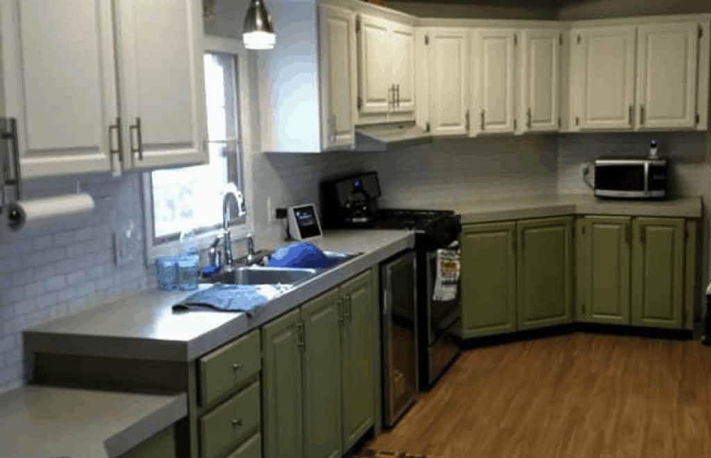 A manufactured home remodel with green and white painted cabinets