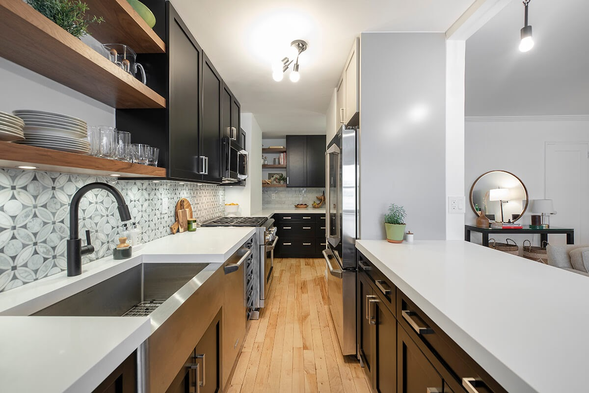 A galley kitchen remodel with optimized cabinet space and combination of light and dark colors to make the space feel expansive