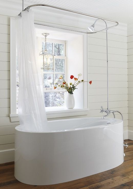 A shower tub remodel that is freestanding, with a heavy curtain surrounding it