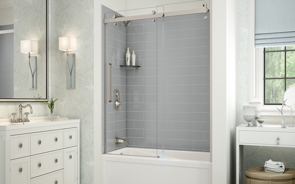 A shower tub remodel with new, grey subway tiles