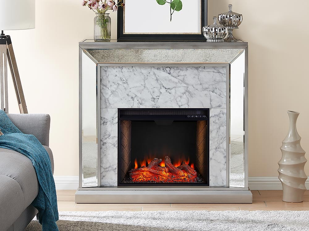 A modern fireplace remodel with a mirror lining the edges of the fireplace