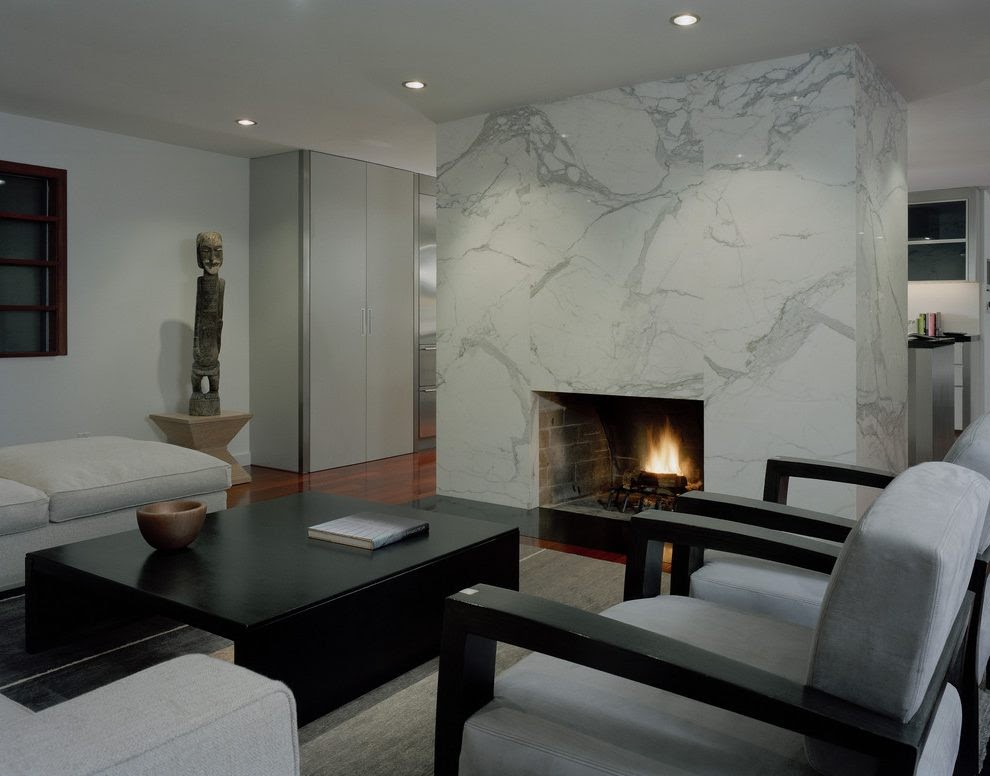 A floor-to-ceiling marble fireplace remodel