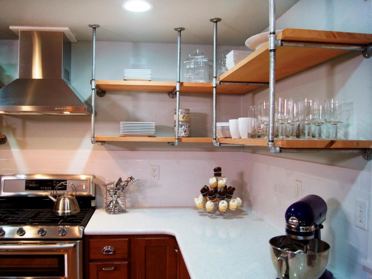 A nice kitchen with an emphasis on shelves instead of cabinets