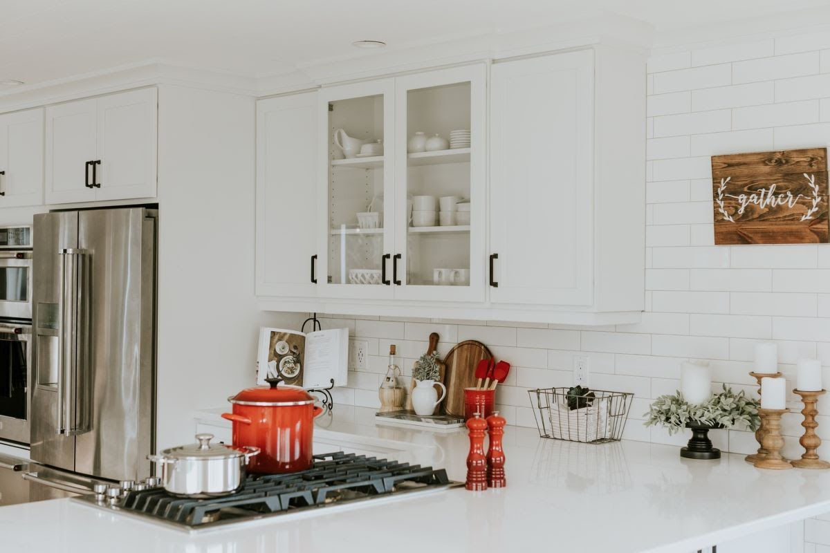 A Kitchen with White Solid Stone Countertops