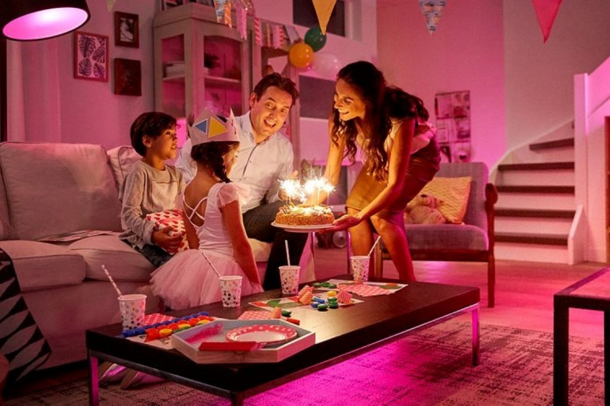 A Birthday Party in a Pink-Lit Room