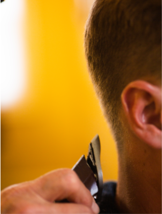 Detail of man's haircut with clippers