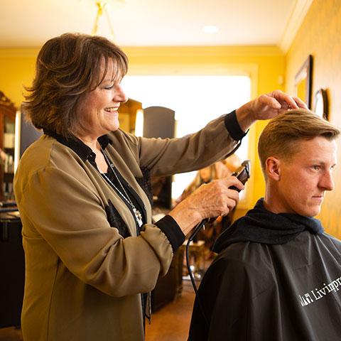 Laura Cuff barbering