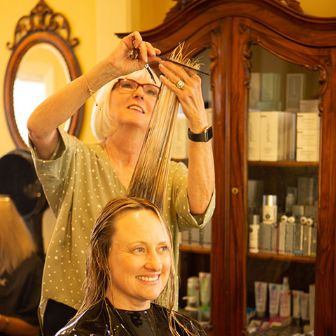 Francesca styling woman's hair