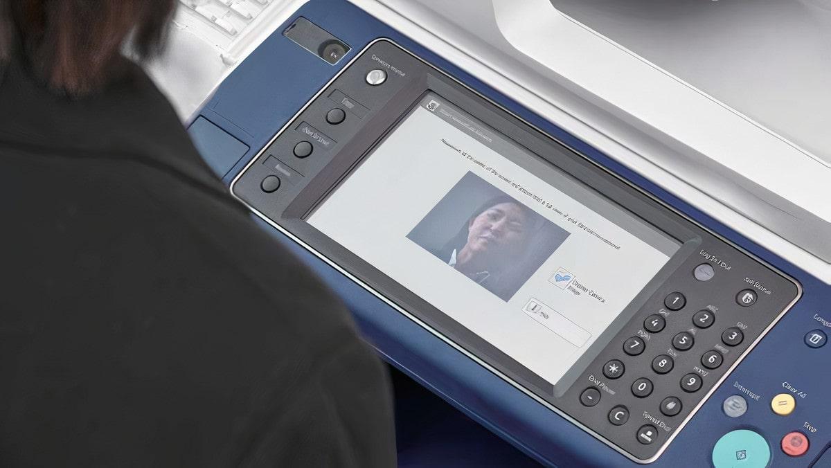 Man Replacing Fuji Xerox Printer Supplies