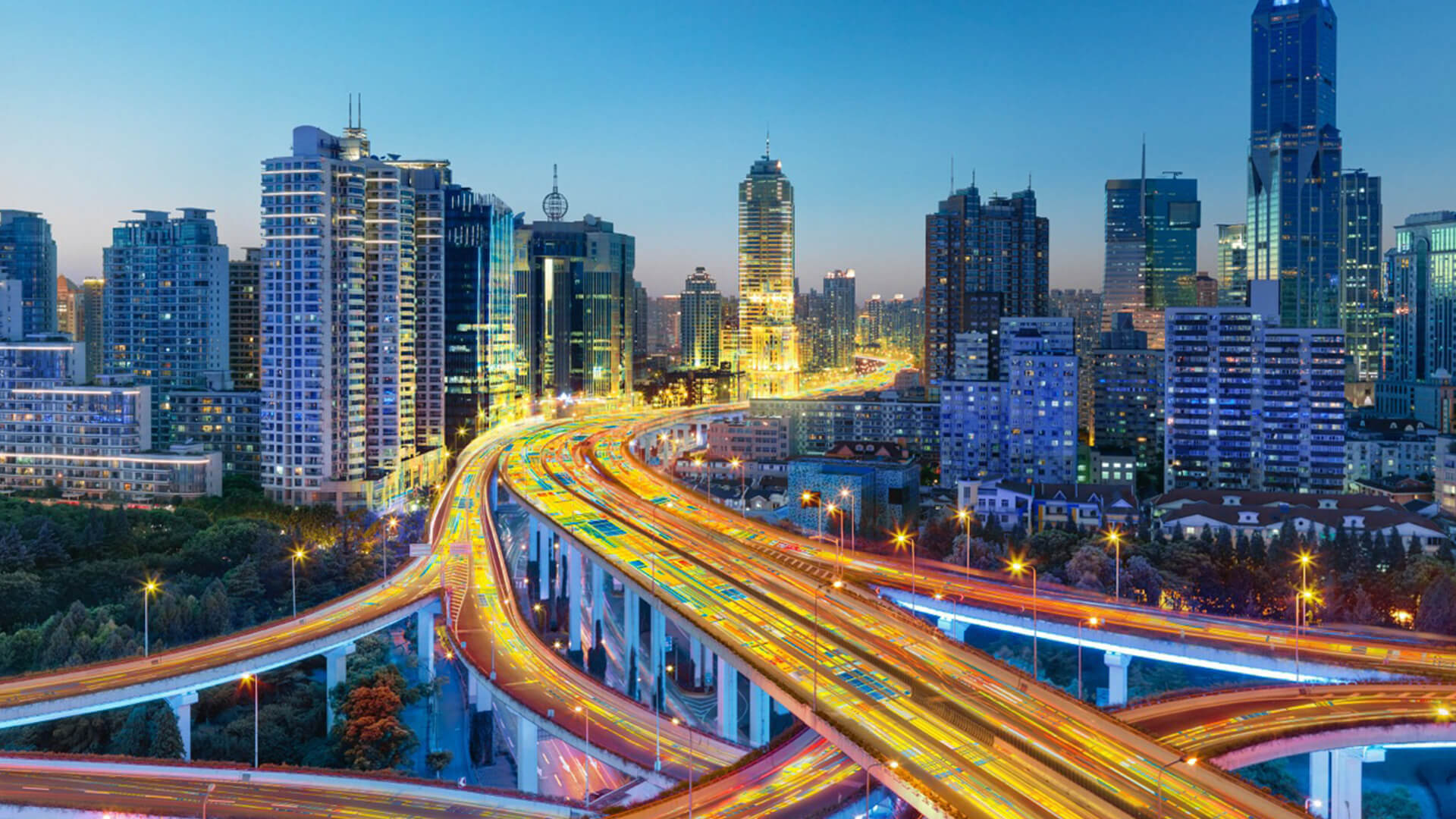 Brightly lit highway in the heart of the city, advertising shot for Intel.