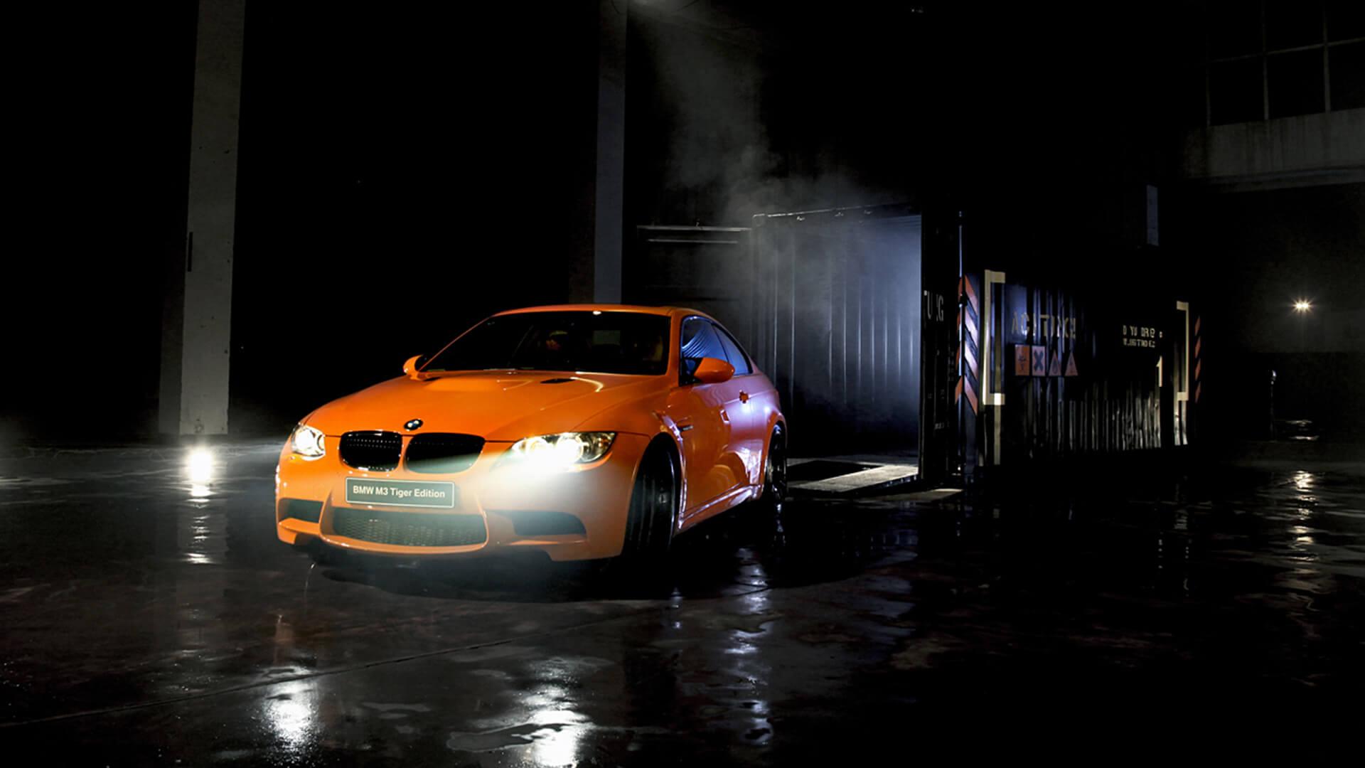 Yellow BMW car on a dark background.