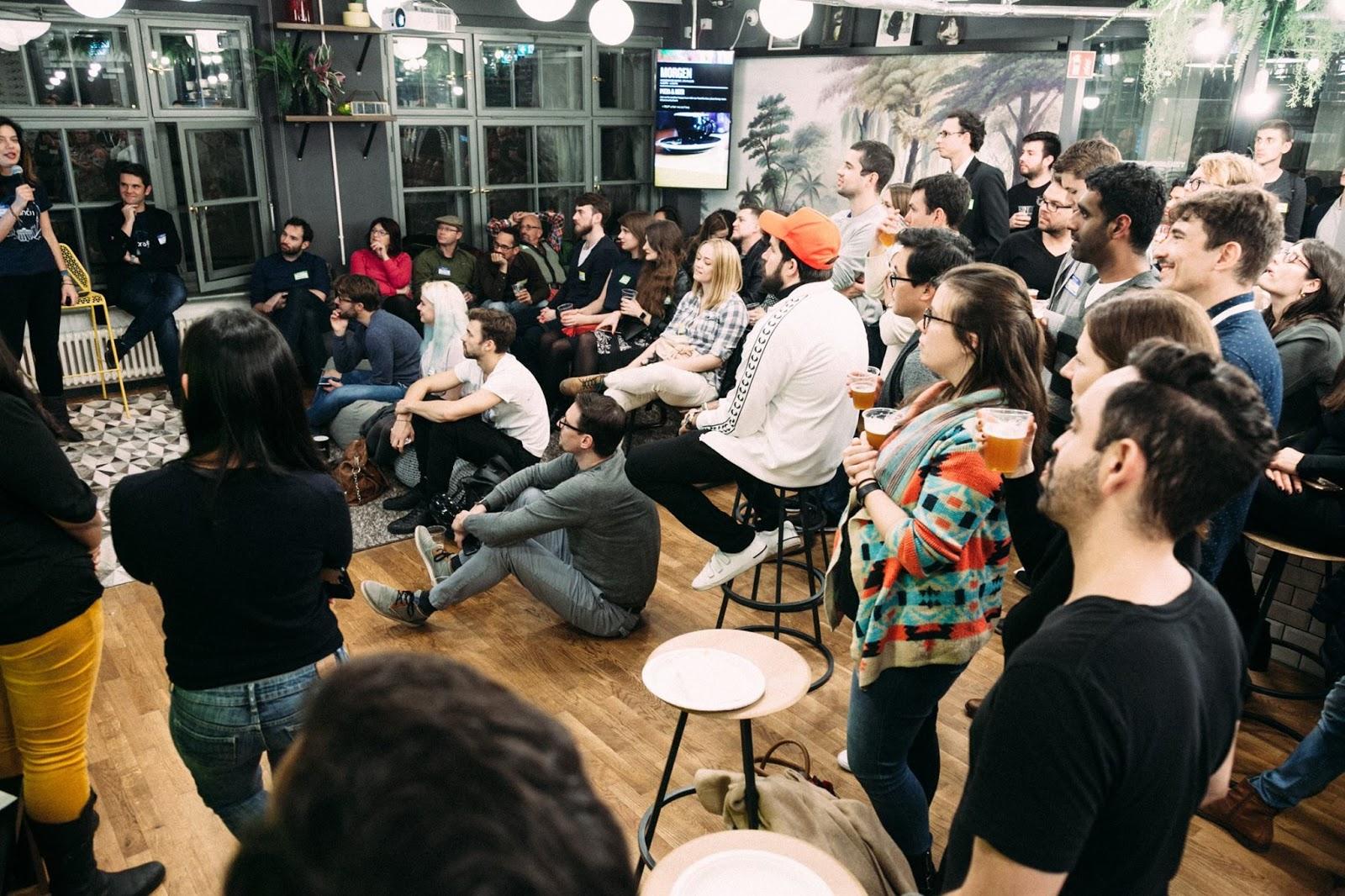 Audience watching panelist speak