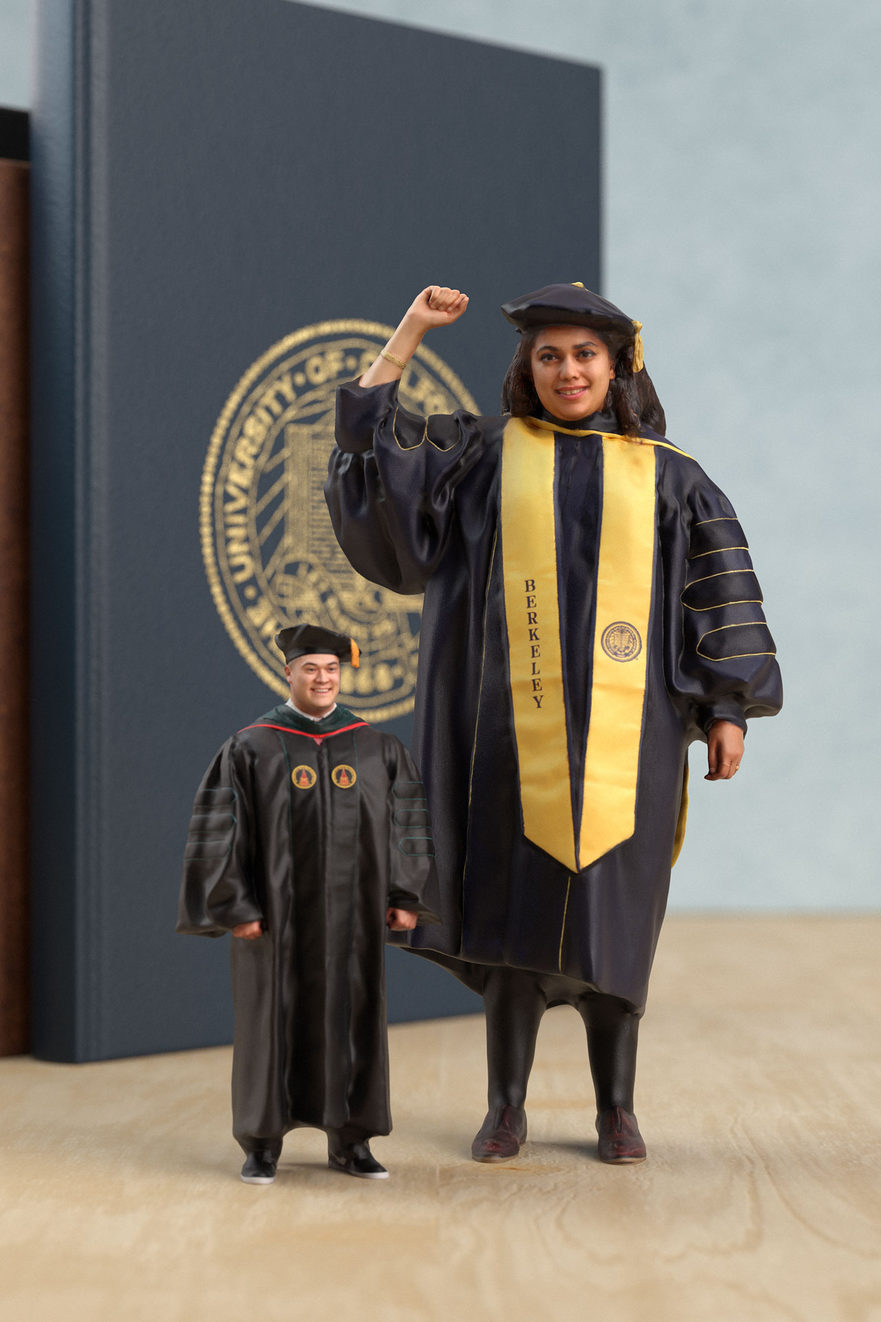 a man and woman in graduation attire.