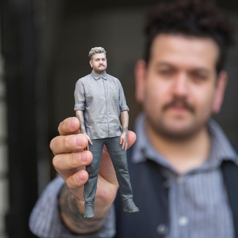 image of man holding a dopl