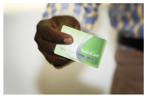 A person holding a Basics Card