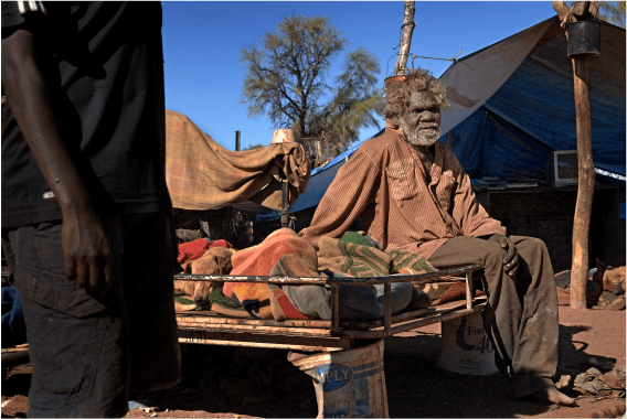 A photo of an indigenous man sitting