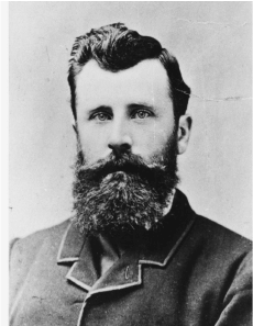 A black and white photo of Charles Winnecke