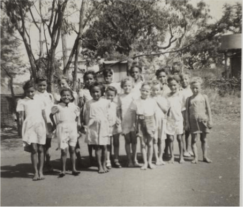 A black and white image of a group of children