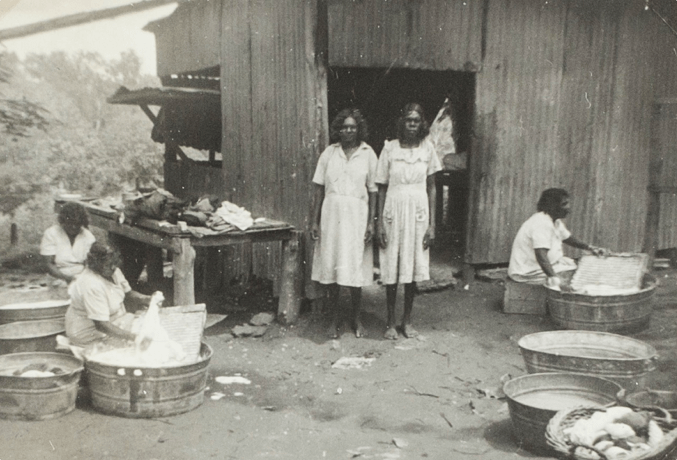 A black and white photo of Aboriginal women doing wash at Manbullo Station (N.T.)