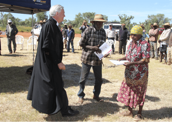 A photo of Banjo receiving the Native Title document for Ooratippra