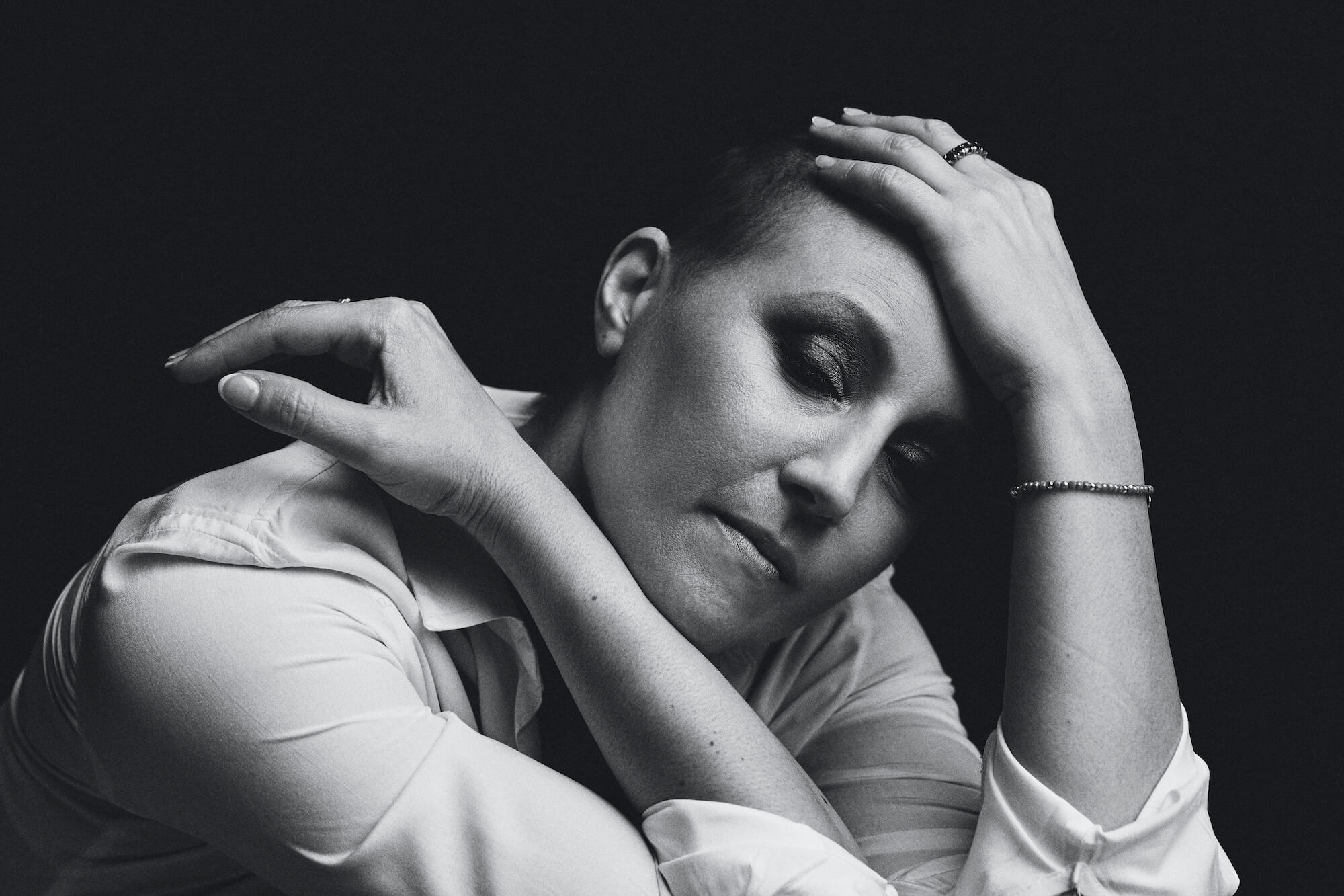 Portrait Series of Daniel Cati, black and white portrait of woman with buzz cut