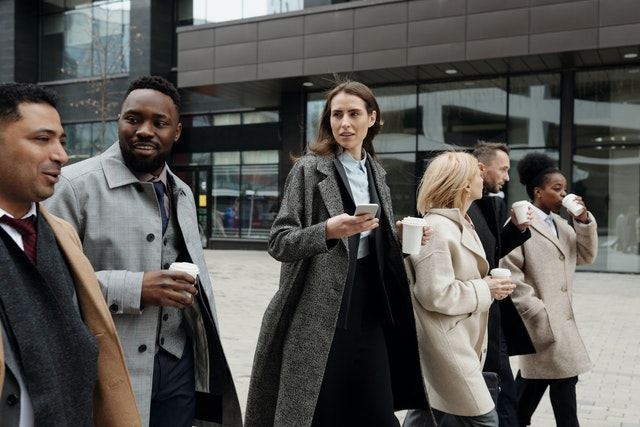 A group of business people walking outside an office