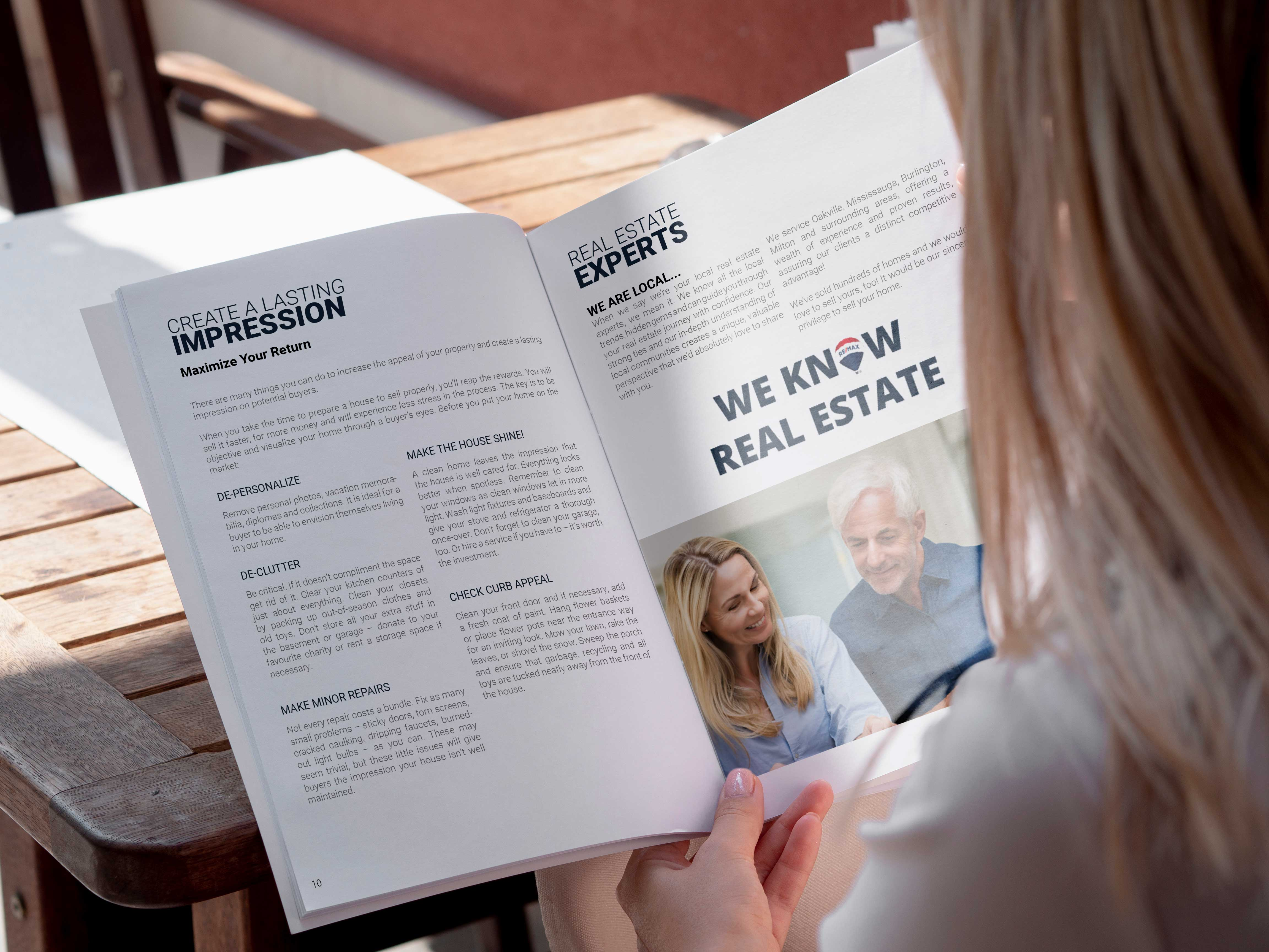 Blonde haired woman reading the sellers guide booklet.