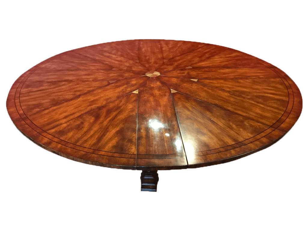A Mahogany Extendable dining table in the manner of Robert Jupe